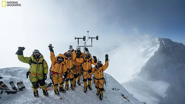 Expedition team celebrates setting up the world's highest operating automated weather station