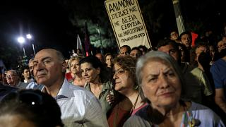 Syriza party supporters listen to a speech of Greek Prime Minister and party leader Alexis Tsipras
