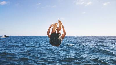 Men's swimwear, man jumping into the sea