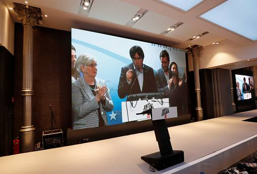 Carles Puigdemont on a television screen