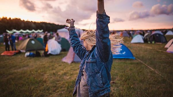Girl at a festival in a campsite