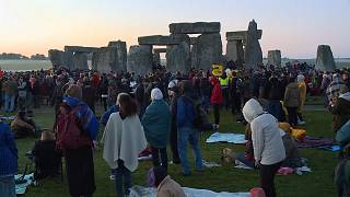 Crowds gather at Stonehenge for summer solstice sunrise