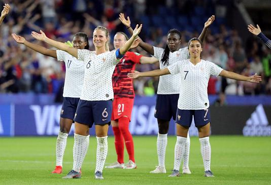 Megan Rapinoe poses after scoring second goal against France