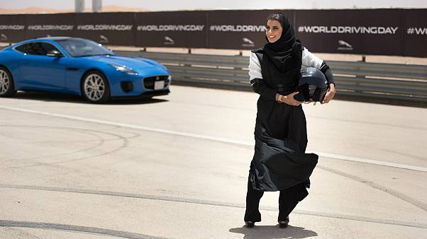 Female racing driver Aseel Al Hamad celebrated the end of the ban on women drivers with a lap of honour in a Jaguar F-TYPE.