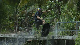 Wakeboarder takes on Bangkok's narrow waterways at speed