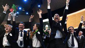 The 2026 Milan-Cortina D'Ampezzo bid team celebrate the Winter Olympic decision.