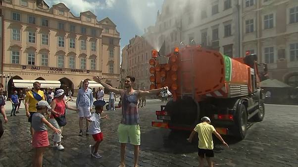 Sprinkler truck sprays people in Prague with water in 37C temperatures