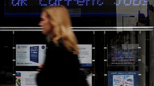 A pedestrian walks past an employment centre in London