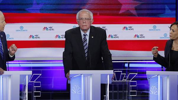 Former Vice President Joe Biden and Senator Kamala Harris debate racial issues as Senator Bernie Sanders listens