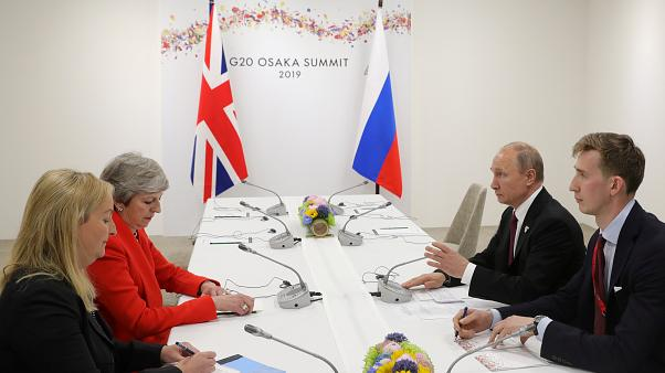 Russia's President Vladimir Putin and Britain's Prime Minister Theresa May attend a meeting on the sidelines of the G20 summit in Osaka, Japan June 28, 2019