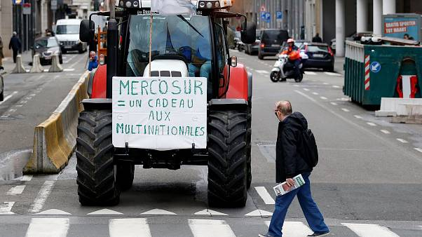 FILEPHOTO: Belgian farmers protest outside a meeting of EU agriculture ministers in Brussels