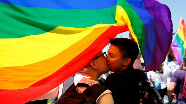 Participants kiss as they take part in the first Gay Pride parade in Skopje.