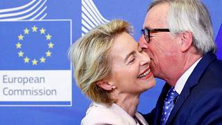 German Defense Minister von der Leyen poses with EU Commission President Juncker in Brussels