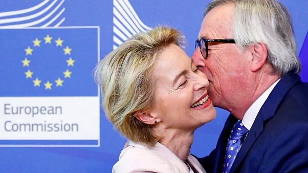 German Defense Minister von der Leyen poses with EU Commission President Juncker in Brussels