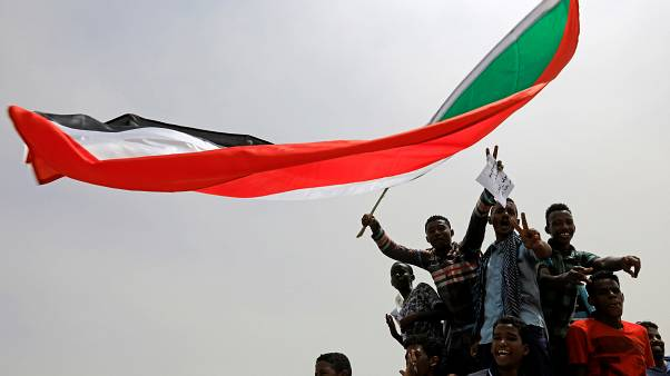 Sudanese shout slogans during a demonstration demanding the ruling military hand over to civilians in Khartoum, Sudan, June 30, 2019.