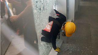 A protester breaks into the Legislative Council building