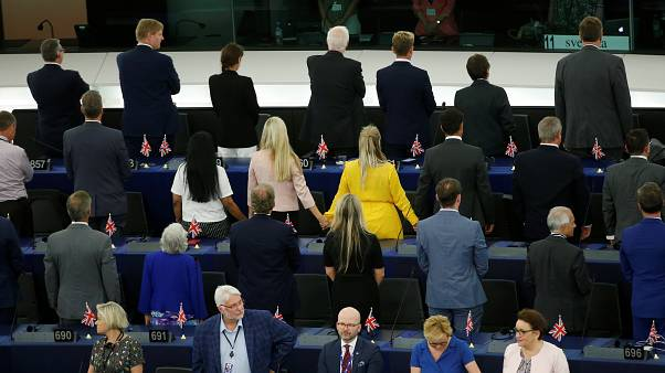 Members of the Brexit Party turn their back to the assembly as the European anthem is played, during the first plenary session of the newly elected European Parliament.