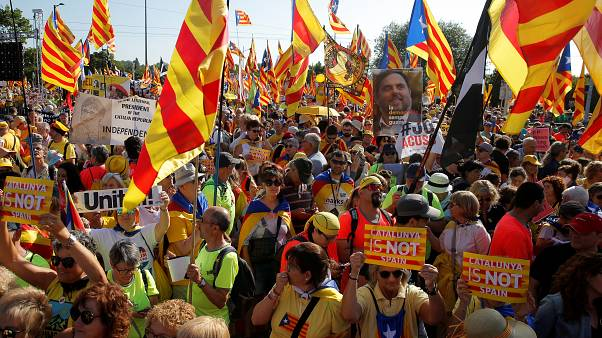 Protesters hold Catalan flags during a demonstration in front of the European Parliament in Strasbourg