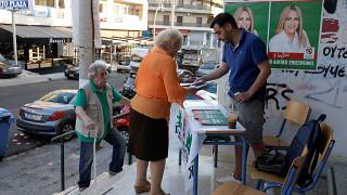 People are seen at a polling station during the general election in Athens, Greece, July 7, 2019.