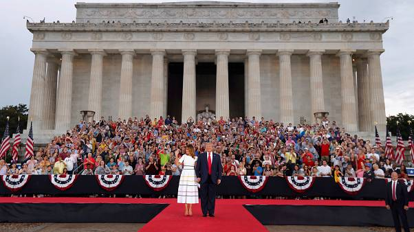 "US President Donald Trump greets the crowd with first lady Melania Trump at the ""Salute to America"" event during Fourth of July Independence Day celebrations"