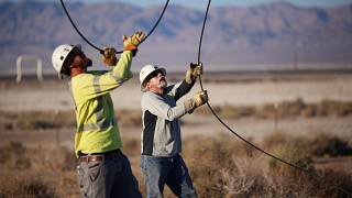 FILE PHOTO: Linemen repair lines that were broken during a powerful earthquake that struck Southern California, July 4, 2019.
