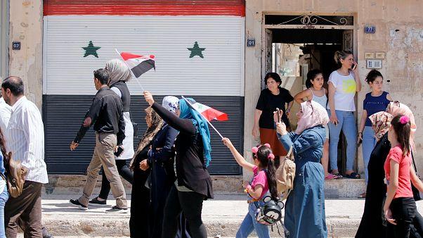 سوريون عائدون إلى مدينتهم القصير يوم الأحد 7 يوليو/تموز