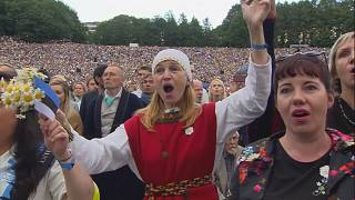 Tens of thousands of Estonians perform mass folk singing