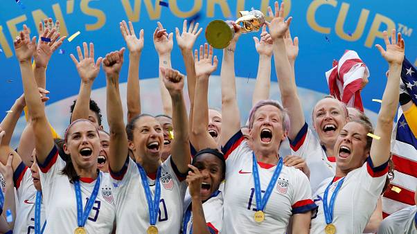 July 7, 2019 Megan Rapinoe of the U.S. and team mates celebrate winning the women's world cup with the trophy