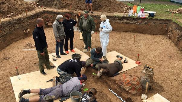 Archaeologists take part in excavation works after they discovered what they believe to be the burial site of French General Charles Etienne Gudin in a park in Smolensk.