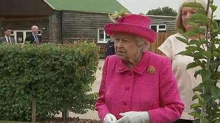 Watch: Queen insists she is 'more than capable' of planting tree on her own