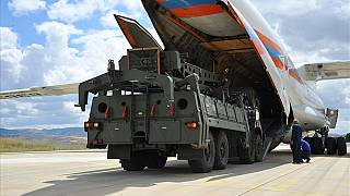 Turkey receives delivery of the first part of a Russian-made missile defence system.