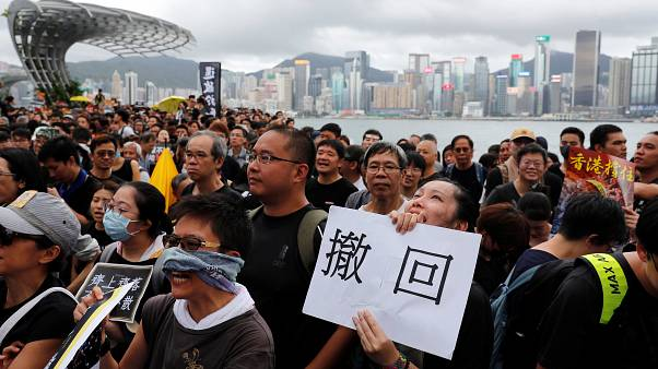 Hong Kong protests: Several thousand march against mainland Chinese traders in town near border