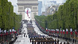 Troops walk down the Champs-Elysees avenue during the Bastille Day parade, Wednesday, July 14, 2021 in Paris.