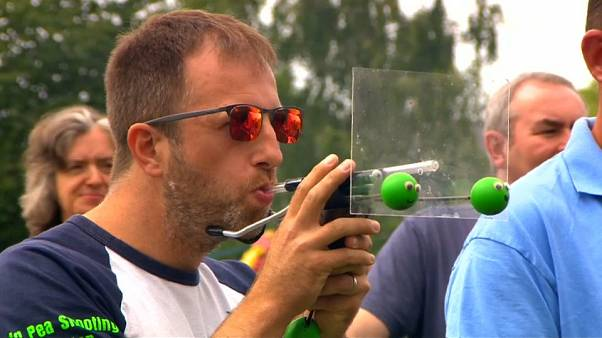 Pea shooting champion puffs a winner in world contest