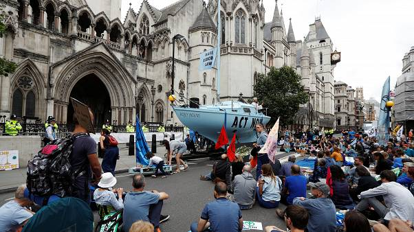Extinction Rebellion climate activists hold a protest outside the Royal Courts of Justice in London, Britain July 15, 2019