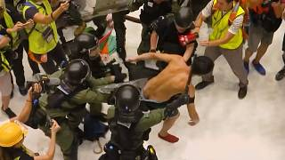 Riot police clash with protesters inside Hong Kong mall