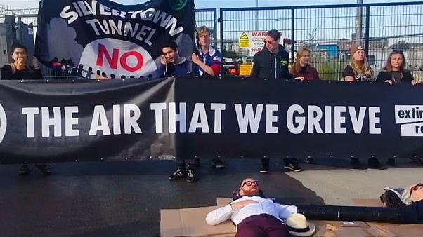 Extinction Rebellion protesters blocking entrance to concrete plant