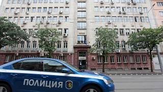 A police car passes past Bulgaria's National Revenue Agency building in Sofia, Bulgaria, July 16, 2019.