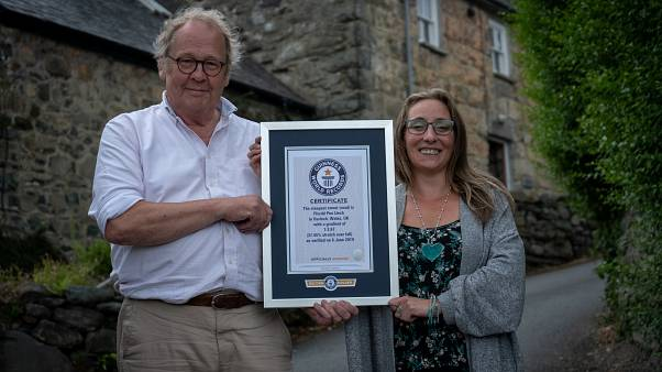 Gwyn Headley and Sarah Badham hold a certificate for the record title for world's steepest street, in Harlech, Wales, Britain July 10, 2019.