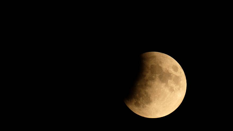 The moon is seen during a partial lunar eclipse in Venice, Italy July 16, 2019.