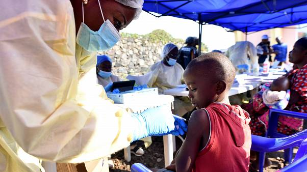 A Congolese health worker administers ebola vaccine to a child at the Himbi Health Centre in Goma, Democratic Republic of Congo, July 17, 2019