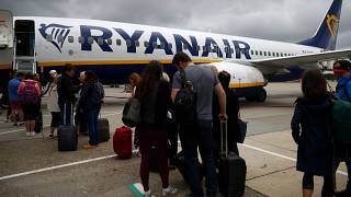 FILE PHOTO: Passengers wait to board a Ryanair flight at Gatwick Airport in London, Britain