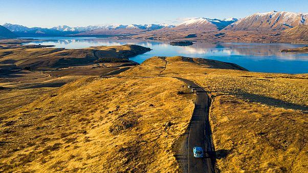 Wiebe Wakker drives his electric vehicle along Lake Tekapo, New Zealand