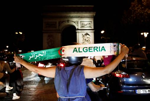 Algeria fans celebrate in front of the Arc de Triomphe in Paris after the match