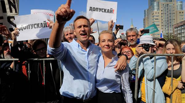 Russian opposition leader Alexei Navalny and his wife Yulia at a rally in support of independent candidates for elections to Moscow City Duma, on June 20.