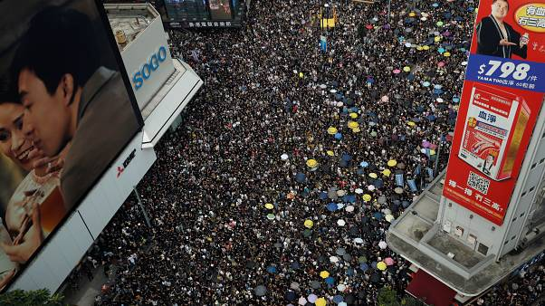 Hong Kong protesters march to demand independent inquiry into police tactics