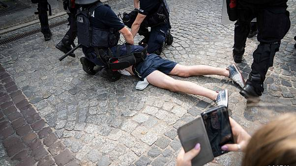 A photo posted on social media of police arresting an anti-LGBT protester