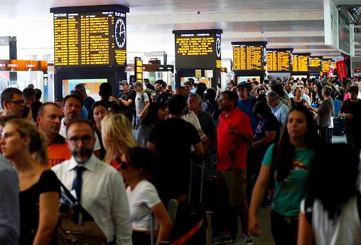 Passengers waiting at Termini station in Rome, after a fire hit the infrastructure around Florence