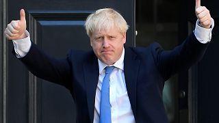 جونسون خلال وصوله إلى مقر حزب المحافظين في لندن بعد الإعلان عن فوزه