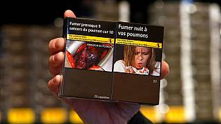 Where do the health warning photos on cigarette boxes come from?
